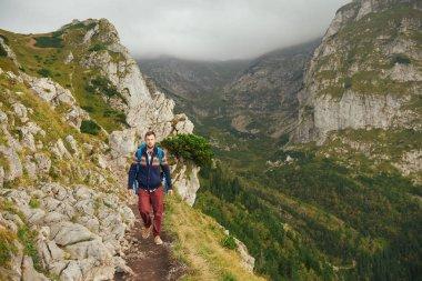 Man walking along trail