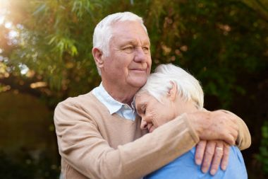 man hugging wife