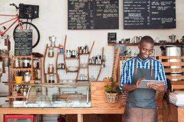 African entrepreneur wearing apron