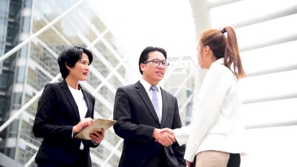 Group of asian business people shake hands and talking in city. Diversity people partner business meeting brainstorming together with businessman trust teamwork. Collaboration Team Meeting concept