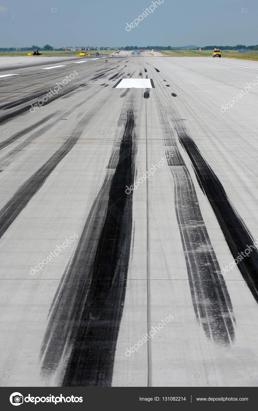 skid marks on runway stock photo yakub88 131082214