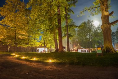 Museum night, Latvia, city Cesis. Park and peoples, trees. 2011