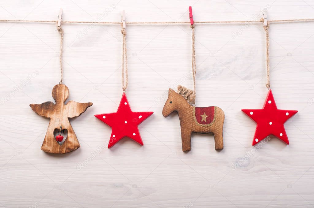 christmas and new year wallpaper background christmas toys in a scandinavian style such as red stars a horse and an angel on a white wooden surface