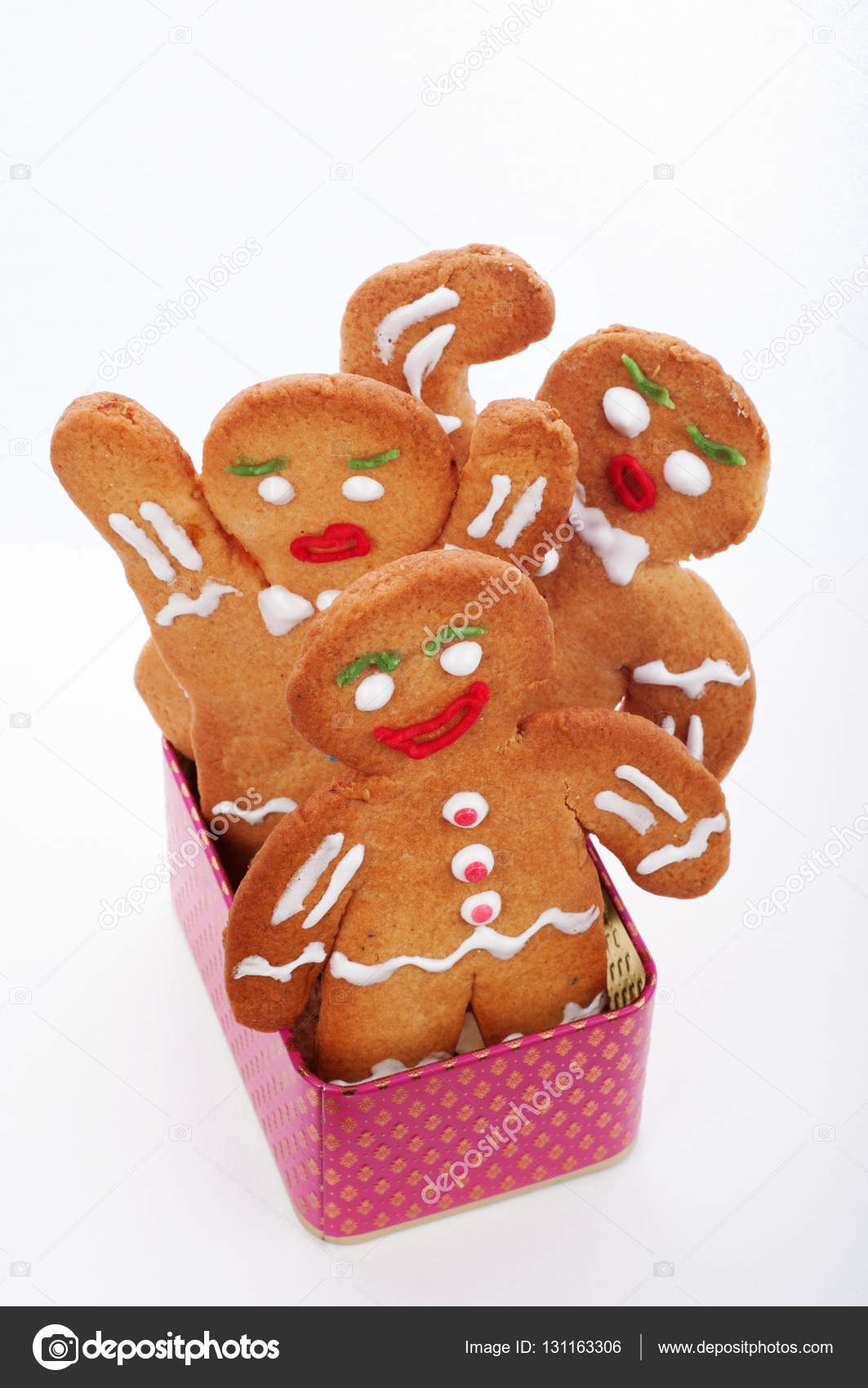 Christmas And New Year Wallpaper Background Gingerbread Men Standing In A Pink Box On White Isolated Object Photo By Nadlobodagmail