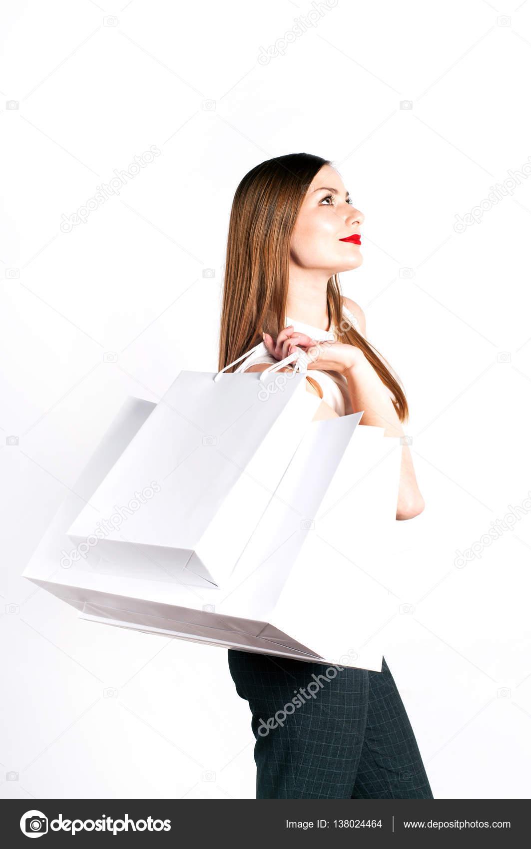 95aa56854f58e9 Schöne junge Frau (Mädchen) mit lange hellbraune Haare in eine weiße Bluse  im Profil