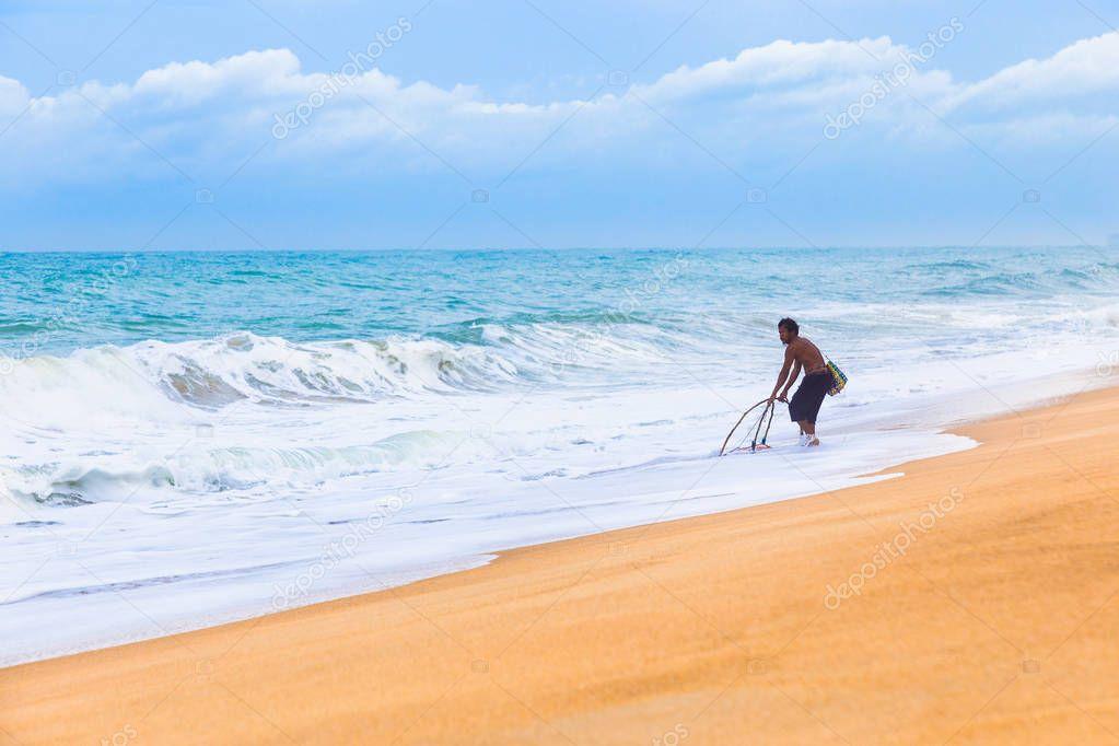 local Phuket fisherman trys to catch fish at a Phuket beach on a