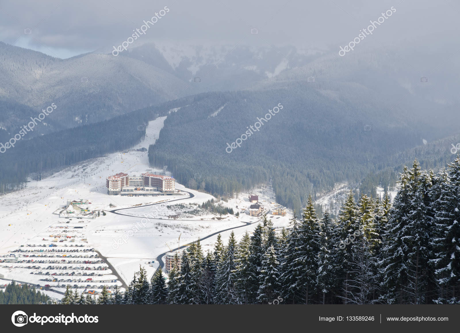panorama of snowy mountains and forest in a ski resort. weather in