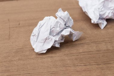 White paper sheet, paper Crumpled paper ball, on a wooden floor background