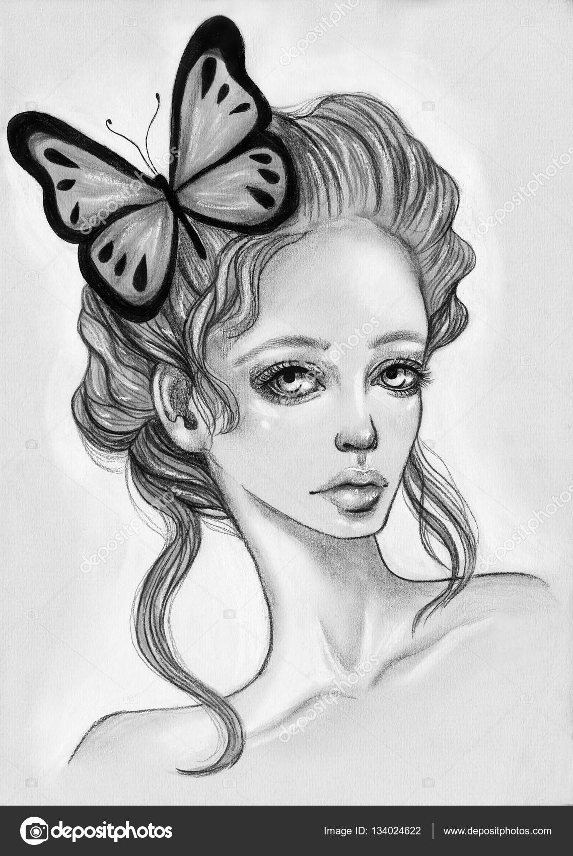 Portrait of beautiful girl with a butterfly in her hair