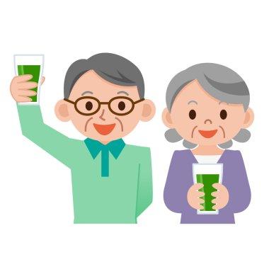 Senior couple drinking vegetable juice