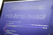 Fotografie Web development phrase ASCII art inside real HTML code. Web developing concept on screen. Abstract information technology modern background. Digital art. Code is created by myself.