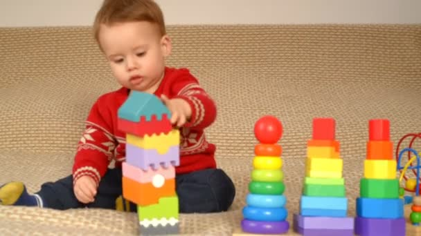Child playing colorful toys