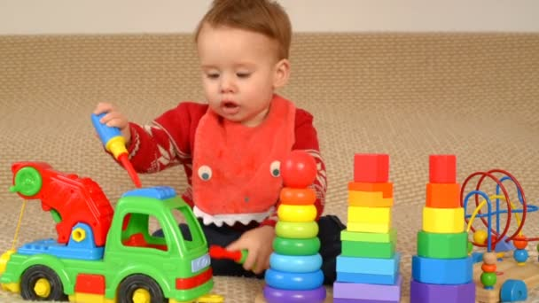 Child playing toy truck