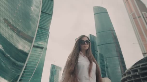 Slow motion. Young beautiful girl. Business woman walking to work in the business center.