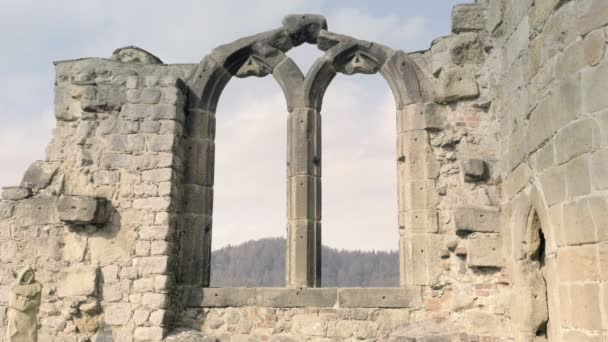 Gothic stone window with arched arch. Gothic cathedral, ruins of medieval castle. Royal City. Spring sunny day, without people. Oybin in Germany.
