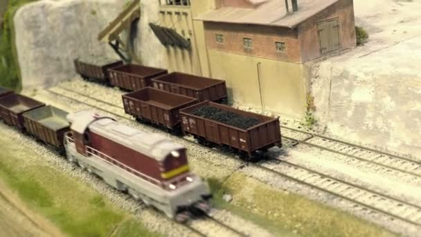Model railroad track  Cargo station in quarry  Miniature train runs through  the curve  Rail transportation, entertainment toy industry