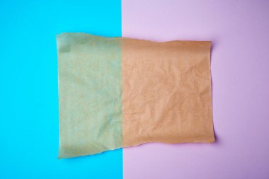 empty brown sheet of parchment paper with curled edges
