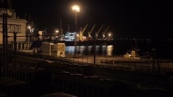 Unloading sulfur in trading seaport at night in Odessa, Ukraine.