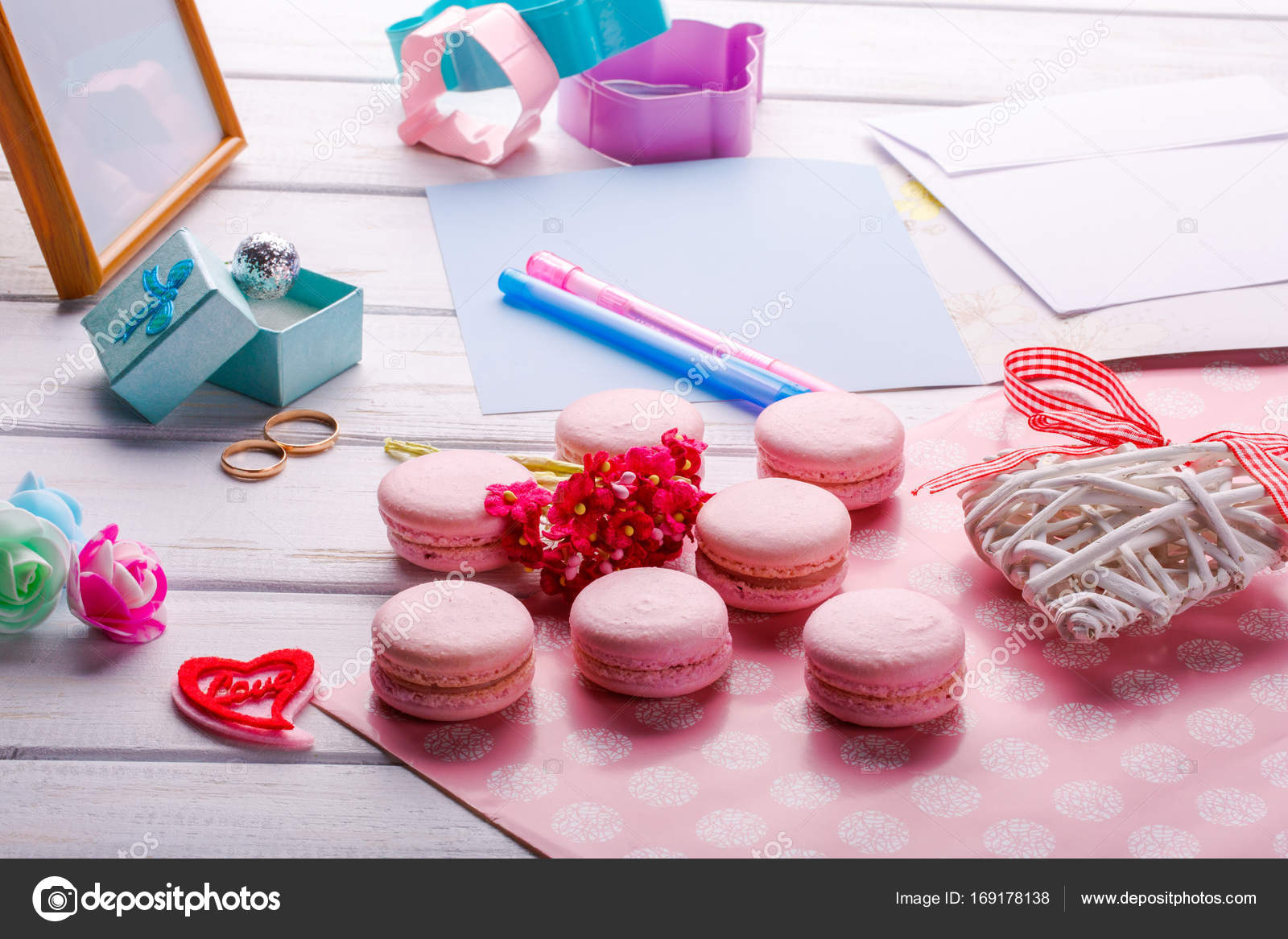 Pink heart shaped macaroons and wedding rings with postcard, Photo ...