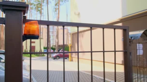 Automatic driveway gate closing at the private house with flasher. entry and exit from the yard