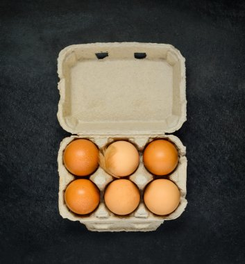 Egg Carton with Brown Organic Chicken Eggs on Dark Background stock vector