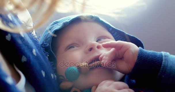 Happy and peaceful little baby at mothers hands during the flight in the plane. Smiling and joyful child and a mother.