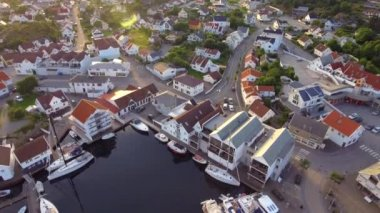 Sea bay of the European modern city, top view. Aerial shot beautiful sea dock in Norway at sunset
