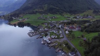 Aerial shot. Small fishing village and the Norwegian fjord. Magnificent nature. Beautiful seascape