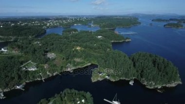 Beautiful scenery of the nature of the Norwegian fjord, aerial shot. Small town on the islands