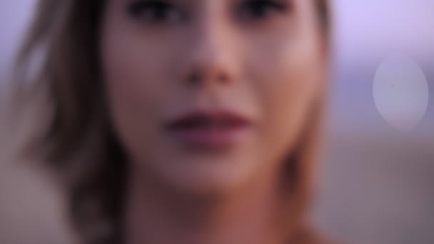 Adorable sexy female mouth showing gesture silence by hand zoom in seductive woman lips