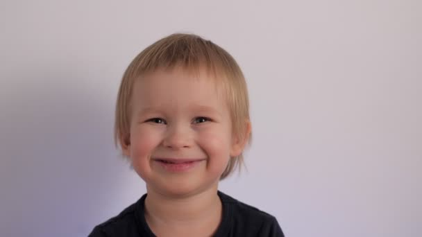 Attractive cheerful baby boy laughing having happy facial expression portrait of cute kid