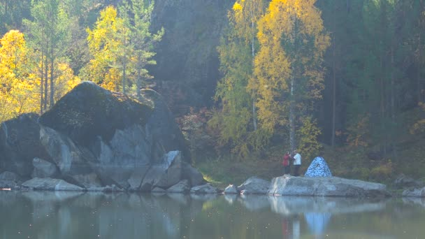 Young Couple in Love on Lake in Woods Near Tent. Panorama Autumn Leaf Sunny Day.