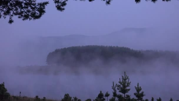 Landscape Fog Over Lake in Mountains Before Dawn