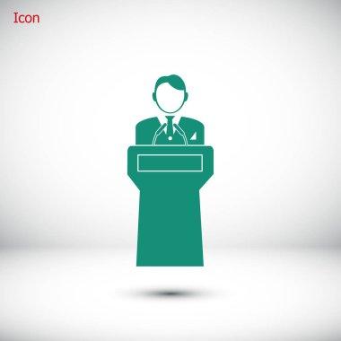 Speaker stands behind podium