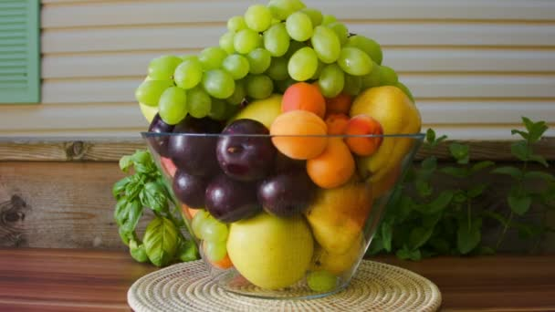 Fresh fruit in a large glass vase