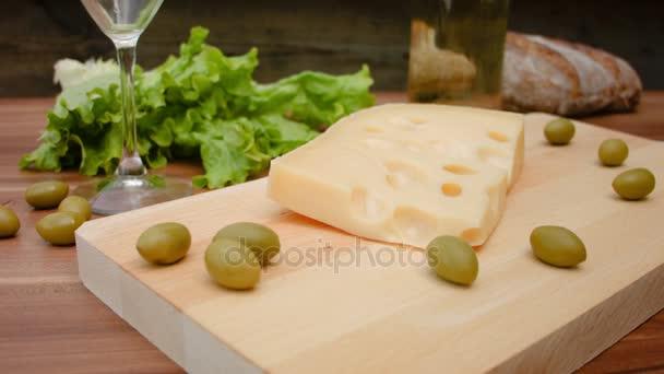 Maasdam cheese on a wooden board