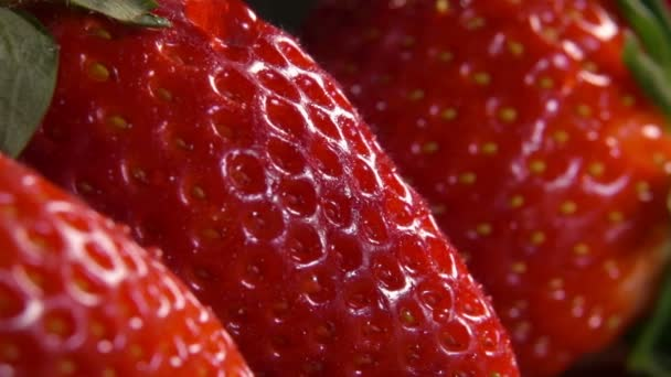 Drop of water dripping on a large ripe strawberries — Stock Video ...