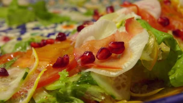 colorful salad with vegetables and pomegranate