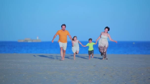 Family runs to sea on the beach