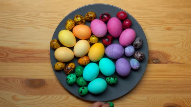 Festive easter eggs laid on a gray plate