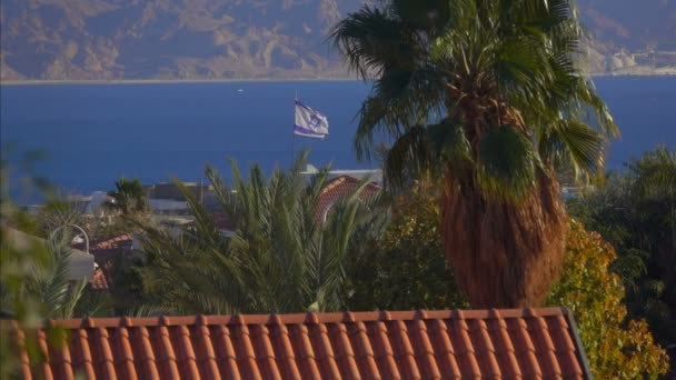 Flag Of Israel fluttering against the blue sea