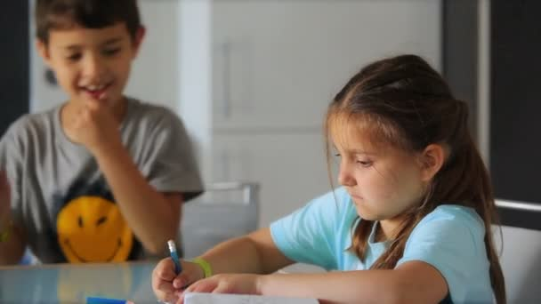 Boy and girl draw and argue