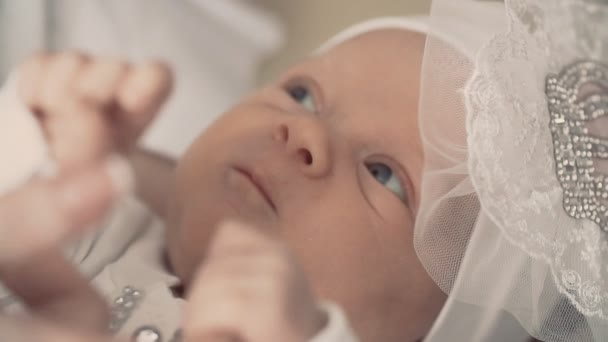 Cute little newborn baby in mothers arms. Close up shot indoors