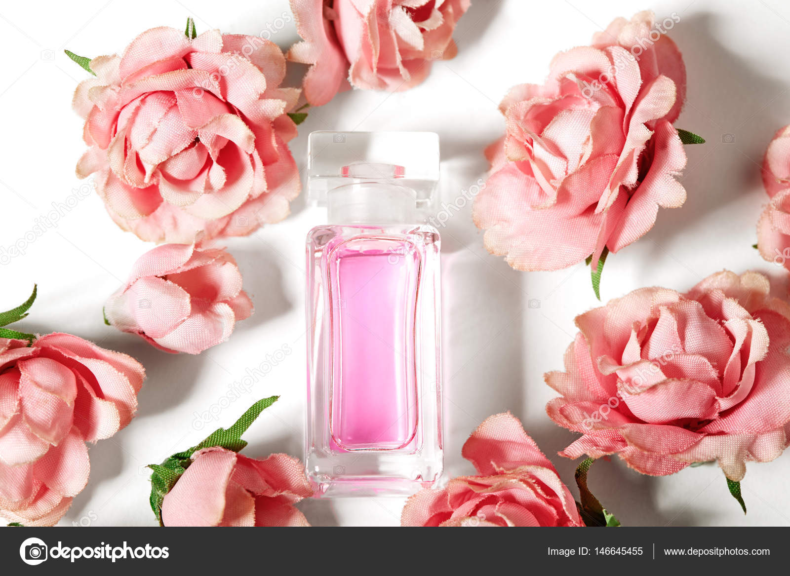 Perfume bottle in pink flower roses spring background with luxury perfume bottle in pink flower roses spring background with luxury aroma parfume beauty cosmetic mightylinksfo