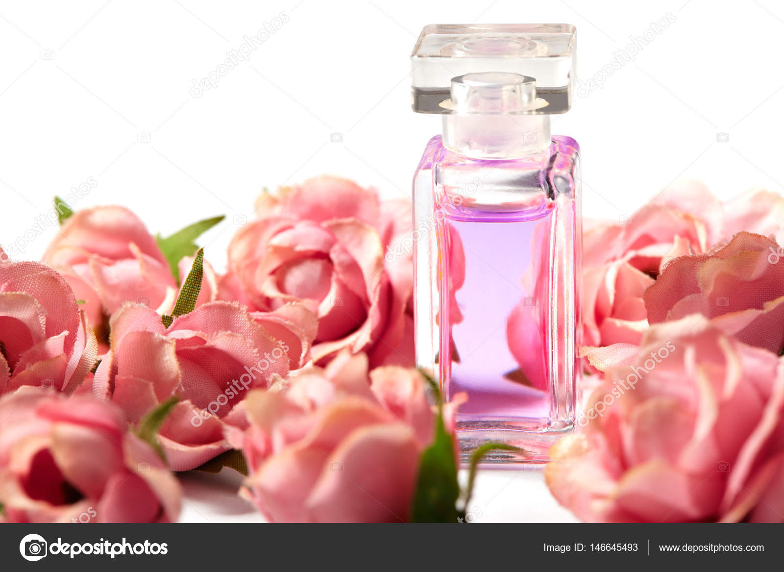 Perfume Bottle In Pink Flower Roses Spring Background With Luxury