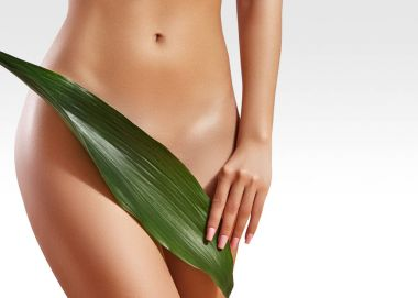Waxing for beautiful woman. Brazilian laser hair removal bikini line an sexy body shapes. Body care and clean skin