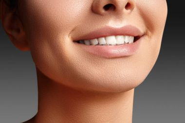 Wide smile of young beautiful woman, perfect healthy white teeth. Dental whitening, ortodont, care tooth and wellness