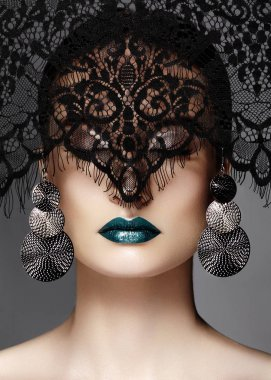 Luxury Woman with Celebrate Fashion Makeup, silver Earrings, black Lace veil. Halloween or Christmas style. Lips Make-up