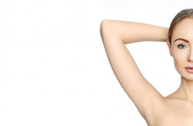 Beautiful woman holding her arms with clean underarms. Epilation