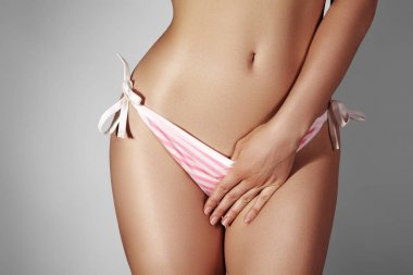 Women Health. Female Menstrual Cycle, Sex and Intimate Routine. Sexy tanned Hips, Sugaring Bikini Epilation